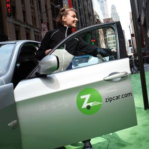 A woman demonstrates a Zipcar in New York City