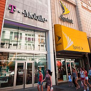 Credit: © Richard Levine/AlamyCaption: T-Mobile and Sprint cellular phone stores in Herald Square in New York