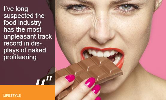 Woman biting on chocolate bar (Image (c) Oppenheim Bernhard/Lifesize/Getty Images)
