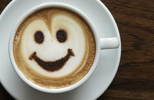 Smiley face in a cup of coffee