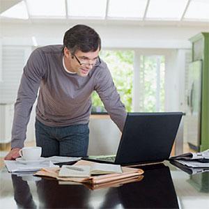 Man looking at laptop © Chris Ryan, OJO Images, Getty Images