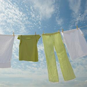 Clothes on a clothesline © Tetra Images / Alamy