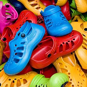 Credit: © Niels Poulsen DK/AlamyCaption: Heap of plastic Crocs shoes