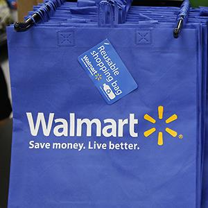 Reusable shopping bags are offered for sale at a Walmart Neighborhood Market © Nick Ut/AP