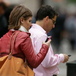 People use cellphones in downtown San Francisco. © AP Photo/Ben Margot