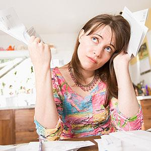 Woman with paperwork © Big Cheese Photo, Jupiterimages