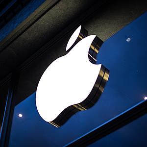 The Apple logo is seen on the facade of the Apple Store