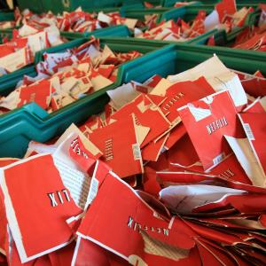 Bins of empty Netflix envelopes will be taken to be recycled in the loading dock of the company's Orlando, Fla., distribution center, pictured August 11, 2009. (c) Ricardo Ramirez Buxeda/Orlando Sentinel/MCT via Getty Images