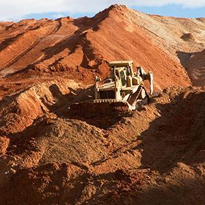 Credit: © Robert Shantz/AlamyCaption: A Caterpillar bulldozer pushes waste at a Freeport-McMoran copper mine in Arizona