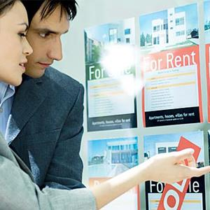 Couple inspecting rental property notices © PhotoAlto/Eric Audras/Getty Images