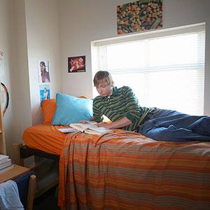 Image: Student in dorm room © Digital Vision Ltd./SuperStock