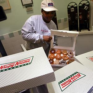 Doughnuts are boxed at the Krispy Kreme store on April 15, 2004 in New York City (© Chris Hondros/Getty Images)