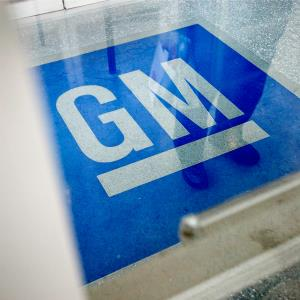 General Motors logo decorates the entrance at the site of a GM information technology center in Roswell, Ga. © AP Photo/David Goldman