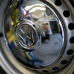 Credit: © Joe Raedle/Getty ImagesCaption: The VW logo is seen on the hubcap of a 1976 Volkswagen camper bus