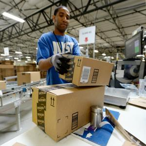 Employee Lamar Roby prepares shipping orders at Amazon's San Bernardino, Calif., Fulfillment Center. Photo by Kevork Djansezian/Getty Images