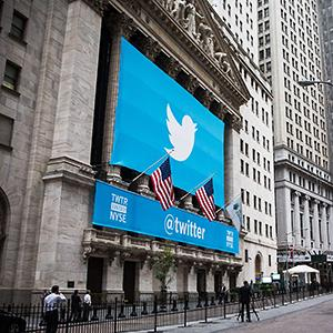 Caption: The Twitter logo is displayed on a banner outside the New York Stock Exchange (NYSE) on November 7, 2013 in New York