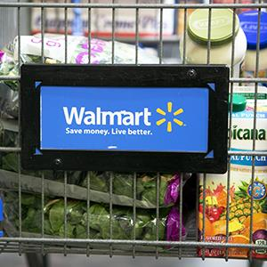 Credit: © Andrew Harrer/Bloomberg via Getty ImagesCaption: Grocery items sit inside a cart at a Wal-Mart store in Alexandria, Va.