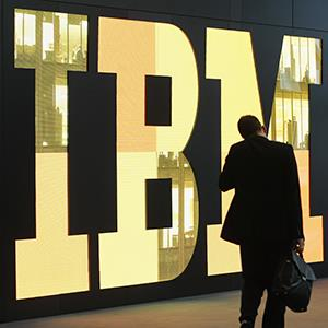 A man walks past the IBM logo at the CeBIT technology trade fair on February 28, 2011 in Hanover, Germany (© Sean Gallup/Getty Images)