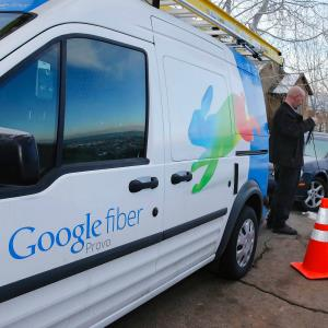 A technician gets cabling out of his truck to install Google Fiber in a residential home in Provo, Utah, Jan. 2, 2014. © REUTERS/George Frey