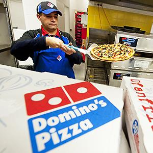 Credit: © Robert Schlesinger/dpa/CorbisCaption: A Domino's Pizza employee prepares a pizza for a customer