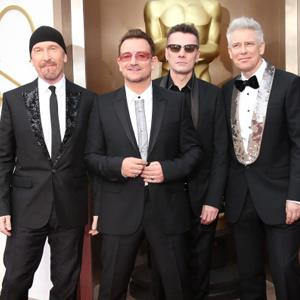 The Edge, Bono, Larry Mullen, Jr. and Adam Clayton of 'U2' arrive at the 86th Annual Academy Awards, Los Angeles© Dan MacMedan/WireImage/Getty Images