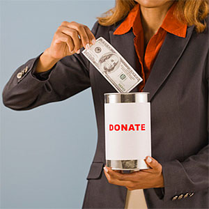 Generous woman donating money © R. Michael Stuckey, Comstock, Getty Images