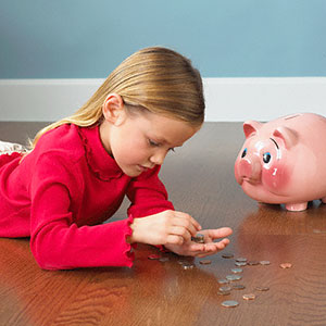 Young girl counting coins © Burke/Triolo Productions/Brand X/Corbis/Corbis