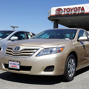 A Toyota Camry parked at a car dealership in San Jose, Calif. Credit: © Paul Sakuma/AP