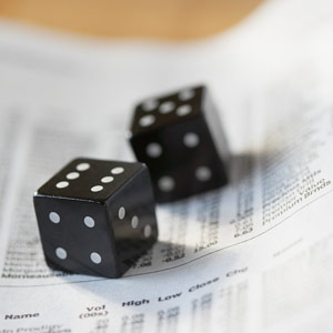 Dice on stock listings © Kate Kunz/Corbis