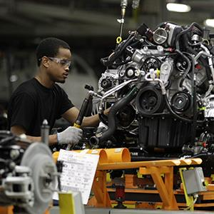 A United Auto Worker works on the assembly line at Chrysler's Jefferson North Assembly plant in Detroit on April 26, 2012 (© Carlos Osorio/AP Photo)