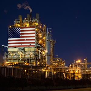 An American flag hangs at a BP oil refinery in Wilmington, Calif. (© Jim West/Alamy)