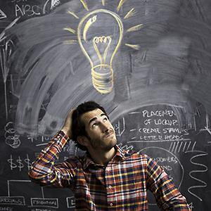 Man getting an idea with light bulb above © Justin Lewis/Getty Images
