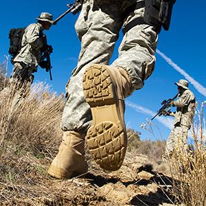 Caption: Soldiers walking in field