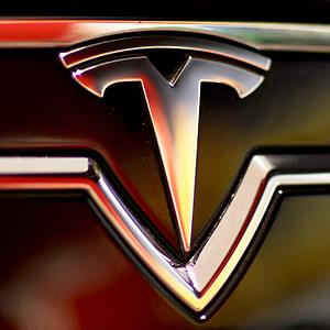 Caption: A Tesla Motors car on the showroom floor in Miami, Fla.Credit: © Joe Raedle/Getty Images