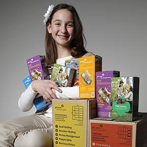 Katie Francis, holds the national Girl Scout cookie sales record. © Doug Hoke/The Oklahoman/AP