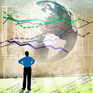 Caption: Illustration of a businessman standing on stock prices looking up at line graphs over globe