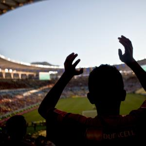 Fans watch a match at newly-renovated Maracana Stadium in Rio de Janeiro, Brazil, on Sunday, April 6, 2014. © Dado Galdieri/Bloomberg via Getty Images