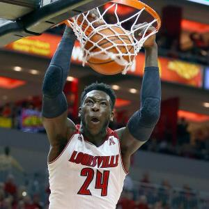 Montrezl Harrell #24 of the Louisville Cardinals dunks the ball during the game against the Connecticut Huskies at KFC YUM! Center on March 8, 2014 in Louisville, Kentucky