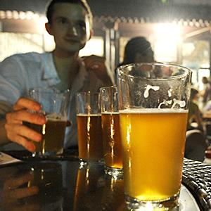 Credit: © Liu Jin/AFP/Getty ImagesCaption: Customers drinking beer outside the Great Leap bar in Beijing