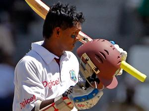 Shivnarine Chanderpaul acknowledges applause after reaching 10,000 Test runs (AP Photo-Andres Leighton)