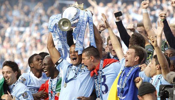 Vincent company lifts Premier League trophy - PA