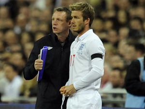David Beckham with Stuart Pearce (Image © Rebecca Naden/PA)