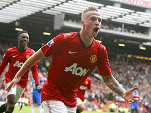 Manchester United's Alexander Buttner celebrates scoring his third goal during the Barclays Premier League match at Old Trafford.