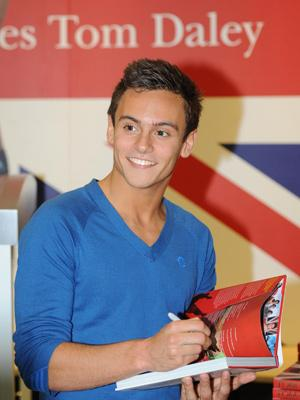 Tom Daley celebrates his success by signing his autobiography
