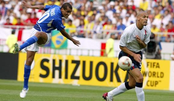 Rivaldo scores against England as Rio Ferdinand turns his back in the 2002 World Cup - PA