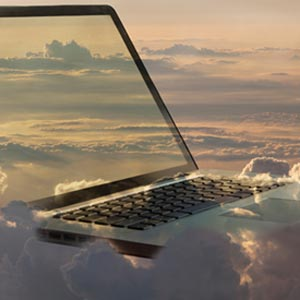 Laptop in the clouds - Buena Vista Images/Getty Images