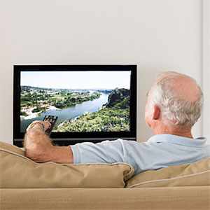 A senior man watching TV © Image Source, Getty Images