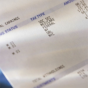 Pay check stub showing taxes withheld © Comstock, Comstock, Getty Images