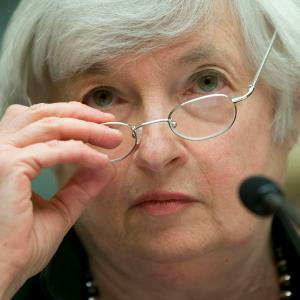In this July 16, 2014, photo, Federal Reserve Chair Janet Yellen removes her glasses as she testifies on Capitol Hill in Washington. © AP Photo/Pablo Martinez Monsivais