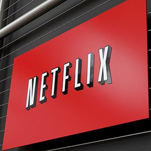The Netflix company logo is seen at Netflix headquarters in Los Gatos, Calif. © Ryan Anson/AFP/Getty Images